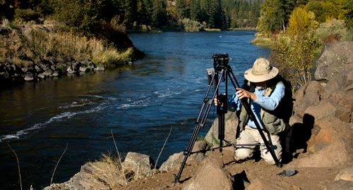 Anders Tomlinson adjusting tripod on the Klamath River.