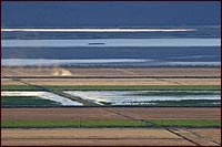 view of tule lake national wildlife refuge farm fields, wlking wetlands and tule lake.  photo by anders tomlinson