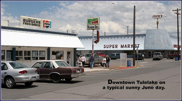 the jolly cone and jock's market are the busy corner on a sunny june day.  tulelake. california.  2005.  photo by anders tomlinson.