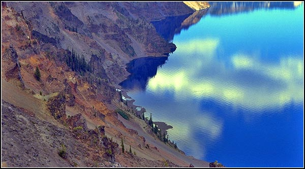 crater lake national park, klamath county, looking down at water and shoreline. photo by anders tomlinson
