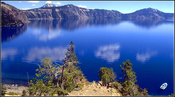 crater lake national park, klamath county, looking down at water and tour boat at cleetwood cove.