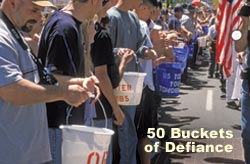 Buckets being passed hand to hand down main street, Klamath Falls, Oregon.  May 7,2001.  The Bucket Brigade.   Photo by Anders Tomlinson.