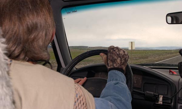 anders driving truck in tule lake basin. photo by Christian Johannson