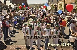 Farm kids from Tulelake 4H lead the Bucket Brigade down Main Street, May 7, 2001.   Klamath Falls, Oregon.  Video still by Anders Tomlinson.