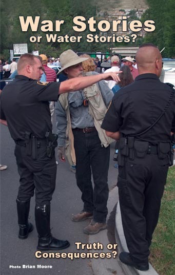 Anders Tomlinson receiving information from police in downtown Klamath Falls, Oregon. July 17, 2003. Photo by Brian Moore.