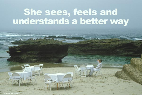 Woman at white tables on beach, La Jolla, ca., 1984.  Photo by Anders Tomlinson