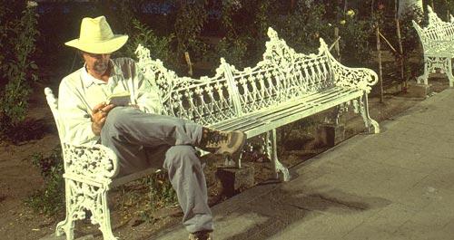 Anders Tomlinson on Plaza bench in Alamos, Sonora, Mexico.  Photo by Antonio Figueroa.
